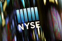 In this May 13, 2019 file photo, the NYSE logo is displayed at the New York Stock Exchange. (AP Photo/Mark Lennihan)