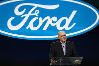 In this Jan. 14, 2018 file photo, Ford President and CEO Jim Hackett prepares to address the media at the North American International Auto Show in Detroit. (AP Photo/Carlos Osorio)