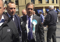 Brexit Party leader Nigel Farage after being hit with a milkshake during a campaign walkabout for the upcoming European elections in Newcastle, England, on May 20, 2019. (Tom Wilkinson/PA via AP)