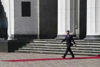 New Ukrainian President Volodymyr Zelenskiy, left, walks after inauguration ceremony in Kiev, Ukraine, on May 20, 2019. (AP Photo/Evgeniy Maloletka)