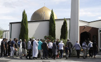 In this March 23, 2019 file photo, worshippers prepare to enter the Al Noor mosque following the previous week's mass shooting in Christchurch, New Zealand. (AP Photo/Mark Baker)