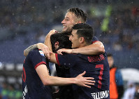 Bologna's Andrea Poli, left, celebrates with Bologna's Riccardo Orsolini after scoring his side's first goal during an Italian Serie A soccer match between Lazio and Bologna, at the Olympic stadium in Rome, on May 20, 2019. (AP Photo/Andrew Medichini)