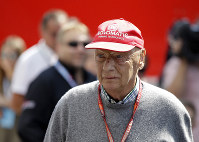 In this July 7, 2018, file photo, former Formula One World Champion Niki Lauda of Austria walks in the paddock before the third free practice at the Silverstone racetrack, Silverstone, England. (AP Photo/Luca Bruno)