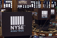 In this Aug. 21, 2018, file photo screens above trading posts on the floor of the New York Stock Exchange show the NYSE logo. (AP Photo)