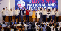 Twelve newly-proclaimed senators raise their hands during a ceremony at the Commission on Elections in suburban Pasay city, south of Manila, Philippines, on May 22, 2019. (AP Photo/Bullit Marquez)