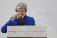 Britain's Prime Minister Theresa May drinks water during a speech in London, on May 21, 2019. (AP Photo/Kirsty Wigglesworth, pool)