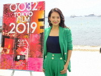 Chinese actress Zhang Ziyi poses next to a poster for the 32nd Tokyo International Film Festival, in Cannes, France, on May 22, 2019. Zhang has been named jury president for the festival's international competition. (Mainichi/Yoshiaki Kobayashi)