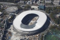 The New National Stadium is seen under construction in Tokyo's Shinjuku Ward in this April 16, 2019 file photo. (Mainichi)