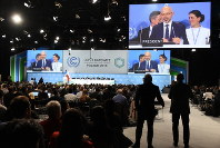 Representatives of the parties to the U.N. Framework Convention on Climate Change are seen after adopting the rulebook of the Paris Agreement at the 24th Conference of Parties to the treaty in Katowice, Poland, on Dec. 15, 2018. (Mainichi/Kazuhiro Igarashi)