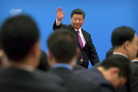 In this April 27, 2019 file photo, Chinese President Xi Jinping waves as he leaves after a news conference in the outskirts of Beijing. (AP Photo/Mark Schiefelbein)