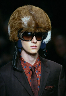 In this Jan. 16, 2006 file photo, a model shows off a furred helmet, during the Prada Fall/Winter 2006/2007 men's fashion collection, presented in Milan, Italy. (AP Photo/Luca Bruno)