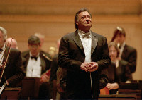In this April 24, 1996 file photo, conductor Zubin Mehta and the Israel Philharmonic enjoy the applause after the performance at New York's Carnegie Hall. (AP Photo/Paul Hurschmann)