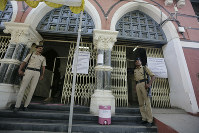 Indian policemen stand guard outside a vote counting center in Ahmadabad, India, on May 22, 2019. (AP Photo/Ajit Solanki)