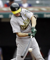 Oakland Athletics' Nick Hundley hits an one-run double off Cleveland Indians relief pitcher Tyler Clippard in the seventh inning of a baseball game, on May 22, 2019, in Cleveland. Ramon Laureano scored on the play. (AP Photo/Tony Dejak)