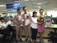 Two same-sex couples pose for a photo at the household registration office to register their legal marriage in Xingyi District in Taipei, Taiwan, on May 24, 2019. (AP Photo/Johnson Lai)