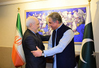 In this photo released by the Pakistan Foreign Office, Pakistani Foreign Minister Shah Mehmood Qureshi, right, shakes hands with Iranian Foreign Minister Mohammad Javad Zarif at the Foreign Ministry in Islamabad, Pakistan, on May 24, 2019. (Pakistan Foreign Office via AP)