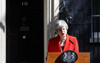 British Prime Minister Theresa May speaks in the street outside 10 Downing Street in London, England, Friday, May 24, 2019. May says she'll quit as UK Conservative leader on June 7, sparking a contest for Britain's next prime minister. (AP Photo/Alastair Grant)
