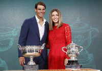 Defending champions Spain's Rafael Nadal, left, and Romania's Simona Halep pose next to the cups during the draw of the French Open tennis tournament at the Roland Garros stadium in Paris, on May 23, 2019. (AP Photo/Michel Euler)