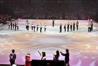 Skaters acknowledge singer ToshI, front center, who produced the music for the