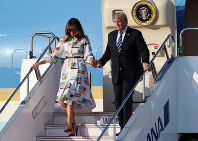 U.S. President Donald Trump and first lady Melania Trump arrive at Haneda International Airport for a state visit on May 25, 2019, in Tokyo. (AP Photo/Koji Sasahara, Pool)
