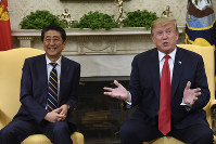 In this April 26, 2019 file photo, U.S. President Donald Trump, right, speaks while meeting with Japanese Prime Minister Shinzo Abe, left, in the Oval Office of the White House in Washington. (AP Photo/Susan Walsh)