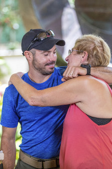 Julia Eller, right, mother of Amanda Eller, hugs rescue lead Javier Cantellops during a news conference about the rescue of Amanda Eller on Saturday, May 25, 2019 in Wailuku Maui. (Bryan Berkowitz/Honolulu Star-Advertiser via AP)