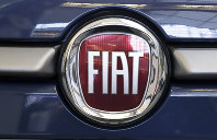 In this Feb. 14, 2019 file photo, the Fiat logo is seen on a 2019 500 L on display at the 2019 Pittsburgh International Auto Show in Pittsburgh. (AP Photo/Gene J. Puskar)