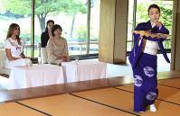 U.S. first lady Melania Trump, left and Akie Abe, wife of Japanese Prime Minister Shinzo Abe, watch the performance of classical Japanese dancing by Yukari Onoe at Akasaka Palace in Tokyo, on May 27, 2019. (AP Photo/Koji Sasahara)