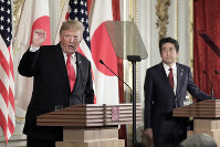U.S. President Donald Trump, left, speaks as Japanese Prime Minister Shinzo Abe listens during a press conference at Akasaka Palace in Tokyo, on May 27, 2019. (Kiyoshi Ota/Pool Photo via AP)