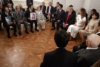 U.S. President Donald Trump and first lady Melania Trump along with Japanese Prime Minister Shinzo Abe and his wife Akie Abe meet with Japanese families of those abducted by North Korea, at Akasaka Palace in Tokyo, on May 27, 2019. (AP Photo/Evan Vucci)