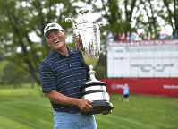 Ken Tanigawa poses with the Alfred S. Bourne Trophy after the Senior PGA Championship golf tournament, on May 26, 2019, in Rochester, N.Y. Tanigawa won the championship. (AP Photo/Adrian Kraus)