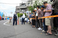 People gather near the scene where children and adults were stabbed in an attack in Tama Ward, Kawasaki, Kanagawa Prefecture, on the morning of May 28, 2019. (Mainichi/Naotsune Umemura)