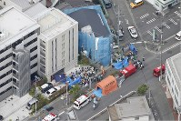 Emergency workers tend to the injured near the scene of a stabbing attack in Tama Ward, Kawasaki, Kanagawa Prefecture, on May 28, 2019 in this photo taken from a Mainichi Shimbun helicopter. (Mainichi)