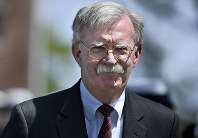 In this May 22, 2019 photo, U.S. National Security Adviser John Bolton arrives to speak at the commencement for the United States Coast Guard Academy in New London, Connecticut. (AP Photo/Jessica Hill)
