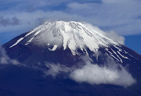 Mount Fuji, Shizuoka and Yamanashi prefectures -- In this file photo taken on June 22, 2013, Mount Fuji -- Japan's highest peak --, appears after rainy season clouds have cleared, in the city of Gotemba, Shizuoka Prefecture, in central Japan. (Mainichi/Koichiro Tezuka)