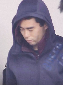Stabbing suspect Yujiro Iimori is seen being taken into the Osaka Prefectural Police's Suita Station on the morning of June 17, 2019, in this frame grab from Mainichi Broadcasting System TV.