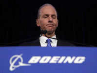 In this April 29, 2019 file photo, Boeing Chief Executive Dennis Muilenburg speaks during a news conference after the company's annual shareholders meeting at the Field Museum in Chicago. (AP Photo/Jim Young)