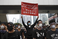 Protesters hold a banner during a march toward the Legislative Council as they continue to protest against the extradition bill in Hong Kong, Monday, on June 7, 2019. (AP Photo/Vincent Yu)