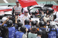Spanish driver Fernando Alonso jubilates as his team win the 87th 24-hour Le Mans endurance race, in Le Mans, western France, on June 16, 2019. (AP Photo/David Vincent)