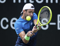 Italy's Matteo Berrettini returns the ball during his final match against Canada's Felix Auger-Aliassime at the ATP Tennis tournament in Stuttgart, Germany, on June 16, 2019. (Silas Stein/dpa via AP)