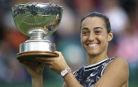 France's Caroline Garcia holds the trophy after beating Croatia's Donna Vekic, to win the women's singles final during day nine of the Nottingham Cup Open tennis championship in Nottingham, England, on June 16, 2019. (Tim Goode/PA via AP)