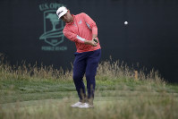 Gary Woodland chips off the 17th green during the final round of the U.S. Open Championship golf tournament on June 16, 2019, in Pebble Beach, Calif. (AP Photo/Marcio Jose Sanchez)