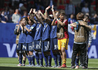 In this June 14, 2019 photo, Japan's players celebrate after winning their Women's World Cup Group D soccer match between Japan and Scotland at the Roazhon Park in Rennes, France. (AP Photo/David Vincent)