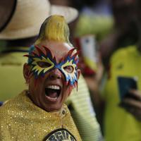 応援するコロンビアのサポーター=AP
