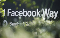 In this April 25, 2019 file photo, an address sign for Facebook Way is shown in Menlo Park, California. (AP Photo/Jeff Chiu)