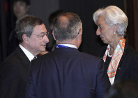 In this June 8, 2019 photo, International Monetary Fund (IMF) Managing Director Christine Lagarde, right, and European Central Bank (ECB) President Mario Draghi, left, speak prior to G20 Finance Ministers' and Central Bank Governors' Meeting on June 8, 2019, in Fukuoka, Japan. (AP Photo/Eugene Hoshiko, Pool)