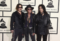 In this Feb. 15, 2016 file photo, from left, Johnny Depp, Joe Perry, and Alice Cooper of The Hollywood Vampires arrive at the 58th annual Grammy Awards at the Staples Center in Los Angeles. (Photo by Jordan Strauss/Invision/AP)
