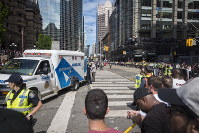 An ambulance arrives to the scene after shots were fired during the Toronto Raptors NBA basketball championship victory celebration near Nathan Phillips Square in Toronto, Canada, on June 17, 2019. (Tijana Martin/The Canadian Press via AP)