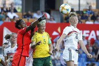 South Africa goalkeeper Andile Dlamini, left, clears the ball against Germany's Linda Dallmann, right during the Women's World Cup Group B soccer match between South Africa and Germany at the Stade de la Mosson in Montpellier, France, June 17, 2019. (AP Photo/Claude Paris)