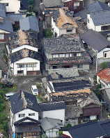 An area where houses were damaged due to a powerful temblor is seen in Tsuruoka, Yamagata Prefecture, on the morning of June 19, 2019. (Mainichi/Koichiro Tezuka)